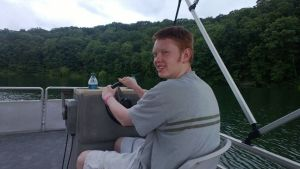 Ash managed to forget his fishing license at the cabin, so he drove the pontoon boat instead.